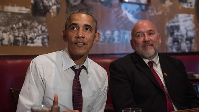 President Obama meets with formerly incarcerated individuals who have previously received commutations in Washington on March 30. With him is Phillip Emmert.  President Barack Obama on Wednesday commuted the sentences of 214 individuals charged mostly with drug-related offenses, as he again pressed the case for drug sentencing reforms.