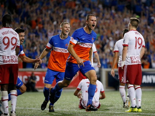 FC Cincinnati defender Austin Berry (22) celebrates