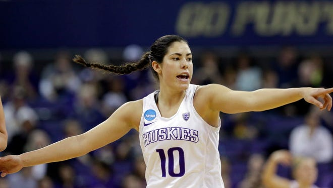 Washington's Kelsey Plum directs her team against Oklahoma during the second half of their second-round game.