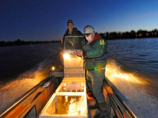 Montrose Area Fisheries Supervisor Joe Stewig (right) uses a gps to navigate Assistant Area Fisheries Supervisor Jason Neuman to the location on Rush Lake near Palmer to electrofish for walleye fry Tuesday, Oct. 14.
