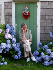 Writer Kurt Vonnegut sits among his beloved hydrangeas