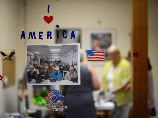 Volunteers work inside the office after Thursday's visit from Gov. Scott Walker at the Republican Party of Wisconsin's Green Bay Field Office in Allouez.