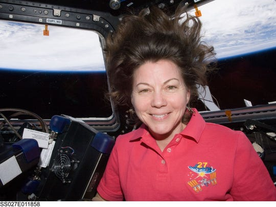 NASA astronaut Cady Coleman, Expedition 27 flight engineer, is in the Cupola of the International Space Station on April 7, 2011.