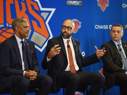Knicks new head coach David Fizdale (C) talks to reporters