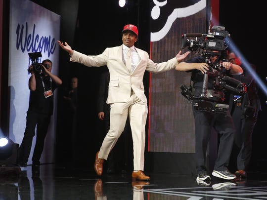 Florida's Vernon Hargreaves III walk on the stage after being selected by the Tampa Bay Buccaneers as the 11th pick in the first round of the 2016 NFL football draft, Thursday, April 28, 2016, in Chicago. (AP Photo/Charles Rex Arbogast)
