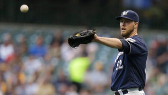 Jimmy Nelson #52 of the Milwaukee Brewers pitches during the second inning against the Pittsburgh Pirates at Miller Park on August 27.