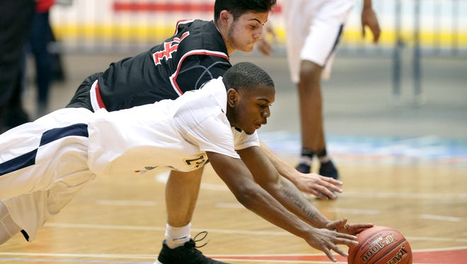 UPrep's J.J. Strothers dives for a loose ball with Hilton's Noah Malta during the Class AA semifinal game.