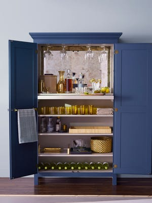 Arrange shelves of your barmoire so the items you reach for most often - liquor and glasses - are closest at hand.  Left, hang a rack inside a door to have a bar towel at the ready.