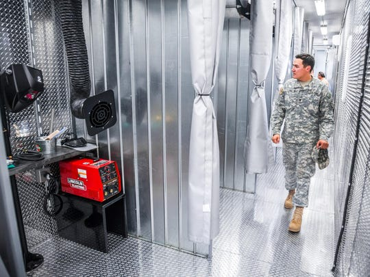 A Fort Polk soldier tours a renovated facility at the Lamar Salter campus of Central Louisiana Technical Community College in Leesville that will be used to train transitioning soldiers in advanced welding technology. The program is offered through a partnership involving CLTCC, Fort Polk, Cheniere Energy Inc. and Bechtel Oil, Gas and Chemicals, and representatives hosted a ribbon-cutting ceremony at the campus on Aug. 17.