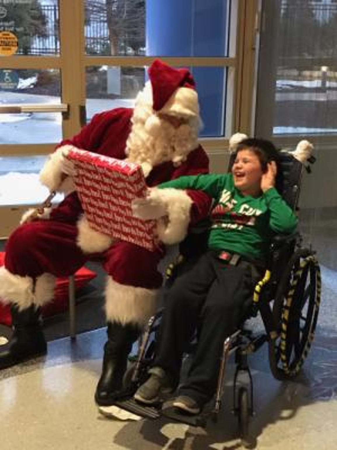 Aiden Busch, 7, got a visit from Santa (actually his