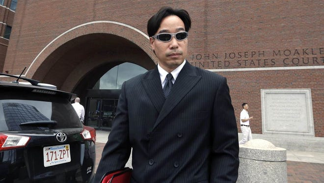Glenn A. Chin, former supervisory pharmacist at the New England Compounding Center, departs federal court in Boston on Sept. 11, 2014.