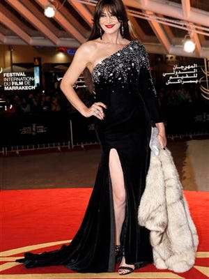 In this file photo, Moroccan transvestite, actress and dancer Noor poses for photographers as she arrives at the Marrakech International Film Festival in Marrakech, Morocco. In this conservative Muslim country where homosexuality is illegal and punishable by up to three years in jail, a transgender woman like Noor is not only accepted but is a celebrity. Her ability to seemingly transcend the restrictions of her culture speaks both to her star power and to a certain kind of tolerance toward sexual minorities in this North African nation, and even in the wider Middle East.
