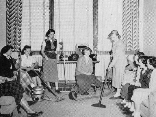 A photo of female students demonstrating various vacuum