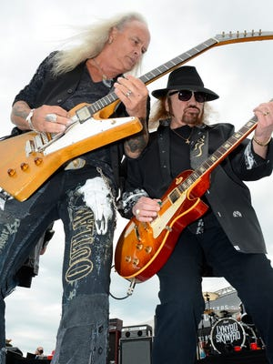Lynyrd Skynyrd band members Rickey Medlocke, left, and Dale Rossington perform before the NASCAR Sprint Cup Series auto race at Texas Motor Speedway in Fort Worth, Texas in 2016. The band will play in Springfield in May.
