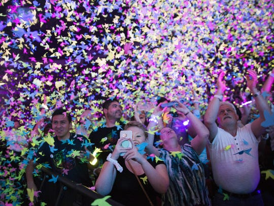 Confetti falls on fans while Coldplay performs at Gila