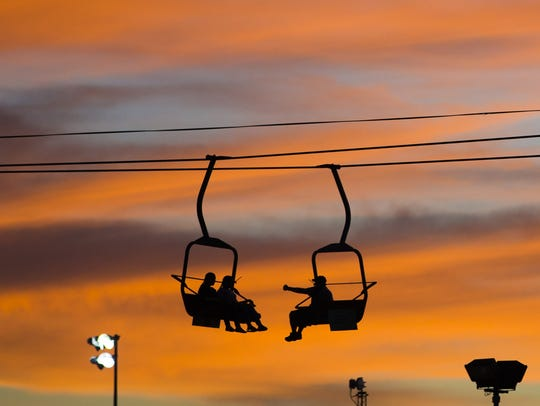 The sun sets on visitors on the Sky Ride at the Arizona