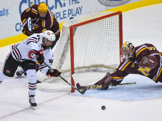 St. Cloud State's Blake Winiecki tries to get a shot