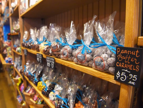 Bags of peanut butter caramels line the shelves at