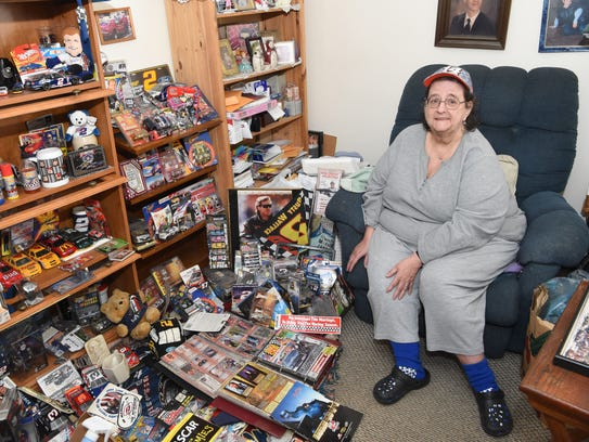 Donna Brunow, 66, sits amid some of her NASCAR memorabilia