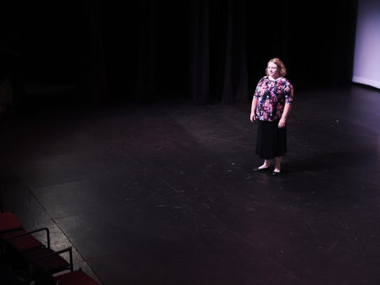 Emily DePew of Tivoli stands on stage at the Center