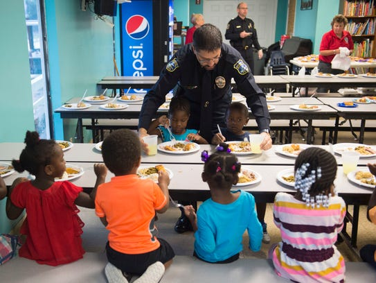Stuart Police Chief David Dyess serves Anyla Byrd, left, 3, of Port St. Lucie and Omarion Williams, 3, of Stuart, on Nov. 16, 2017 at the Gertrude Walden Child Care Center in Stuart. The Child Care Center's annual Spaghetti Dinner & Raffle Fundraiser is up next on Feb. 23.  Dinner will be served for $5 per person.