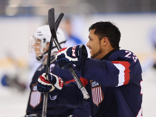 Rico Roman, right, was one of the U.S. sled hockey