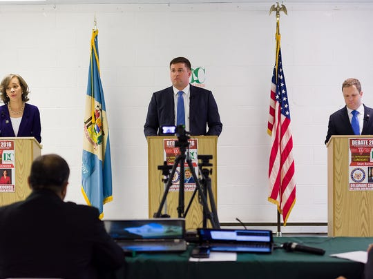 Lisa Blunt Rochester, Bryan Townsend, and Sean Barney make remarks at the Congressional debate hosted by Delaware Council on Global and Muslim Affairs at the UAW Conference Hall in Newark on Monday.