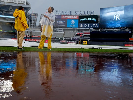 Members of the New York Yankees grounds crew check