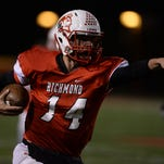 Richmond's Jordan Christian points toward the endzone as he scrambles for a first down against Lafayette Jeff during a football game Friday, Oct. 2, 2015, at RHS.