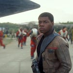 """Rey (Daisy Ridley), Finn (John Boyega) and droid BB-8 are stalwarts of a new """"Star Wars"""" trilogy."""