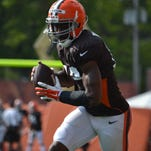 Browns wide receiver Nate Burleson secures the football after making a catch along the sideline in Wednesday's training-camp practice.