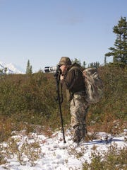Artist Chad Poppleton shoots reference photos for his art. Poppleton uses long lenses in order to disturb wildlife as little as possible while he observes them.