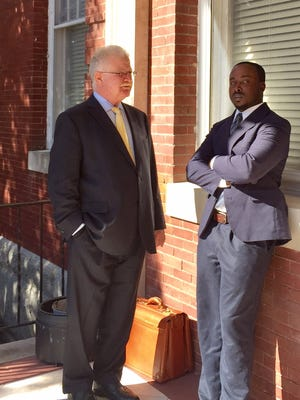 In this Nov. 15, 2016 photo, Princess Anne Town Commissioner Lionel Frederick (right) talks with his attorney, William A. Lee Clarke III of Salisbury, outside the Circuit Courthouse in Princess Anne. Frederick, found guilty of extortion involving an elected official and misconduct in office, is set for a Jan. 9 sentencing.