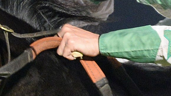 Enlarged view of jockey Roman Chapa's left hand in the Sam Houston Race Park race that led to Chapa being suspended after allegations he used an illegal buzzer.