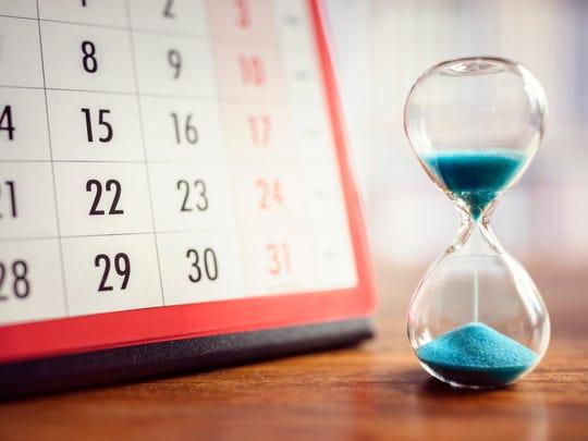 A calendar and a sand clock