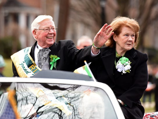 Grand Marshal Tom Flynn and his wife, Pauline, ride