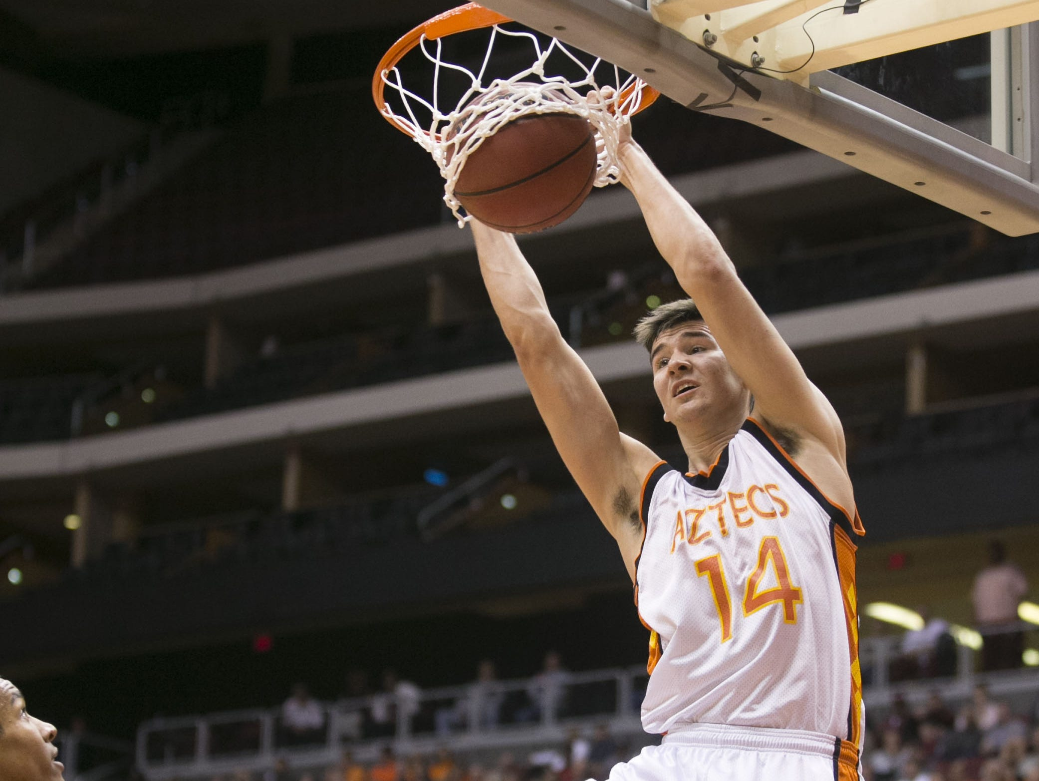 Corona del Sol's Dane Kuiper dunks the ball against Desert Vista in the second half during the D1 State Final game at Gila River Arena in Glendale, AZ.