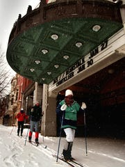 People cross country ski past the Strand-Capitol Performing Arts Center on North George Street in York the day after the Blizzard of 1996 hit. The blizzard started on Dec. 7 and continued into Dec. 8.