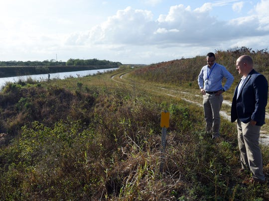 Port St. Lucie Utilities Director Jesus Merejo (left) and Mayor Greg Oravec stand along the C-23 Canal that runs adjacent to McCarty Ranch Preserve. City officials plan to build reservoirs on the land that will remove polluted water from the canal that would normally flow into the St. Lucie River and Indian River Lagoon.