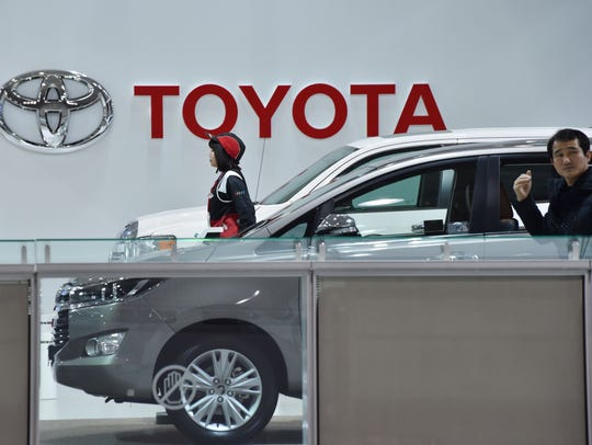 Visitors are seen in a showroom of Japan's Toyota Motor