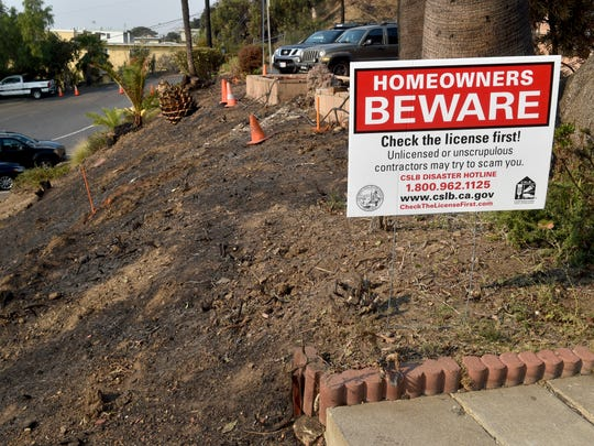 Signs warning of potential scams were on display Wednesday at an assistance center set up to help Thomas Fire victims. Several local and state agencies were at the Poinsettia Pavilion in Ventura to offer information and services to victims of the blaze.