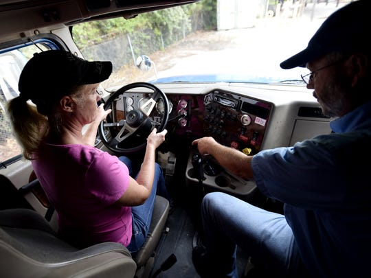 A student undergoes truck-driving training.