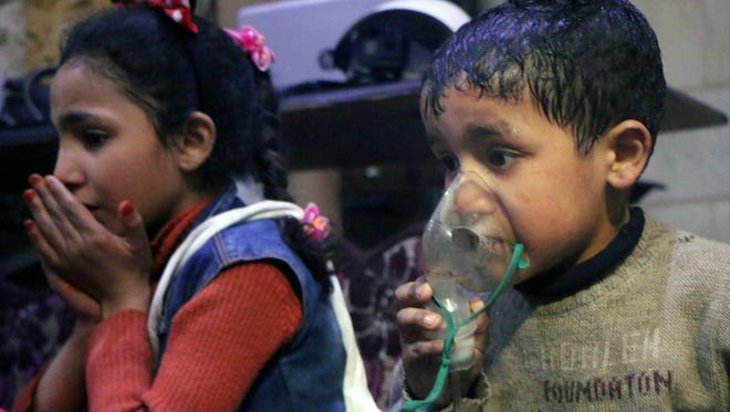 This image released early April 8, 2018, by the Syrian Civil Defense White Helmets shows a child receiving oxygen after a suspected poison gas attack in the rebel-held town of Douma near Damascus.