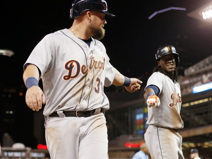 Detroit Tigers' Casey McGehee, left, is congratulated