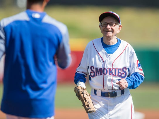 Lifelong Chicago Cubs fan Moe Resner throws out the