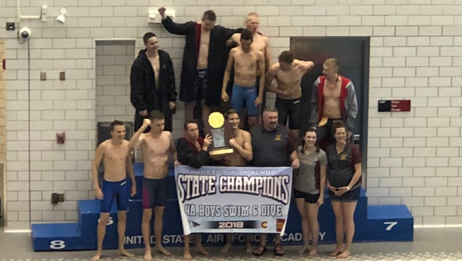 Windsor High School's boys swimming team celebrates May 19 after winning the Class 4A state title at the Air Force Academy.