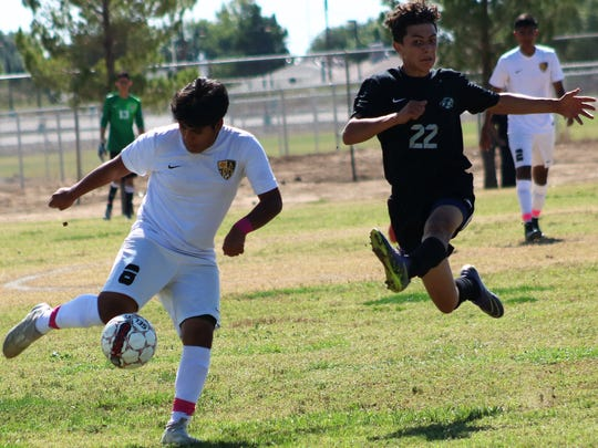 Alamogordo's Jr. Barbosa, left, tries to pass a ball while being pursued by Chaparral's Ricardo Alvarado.
