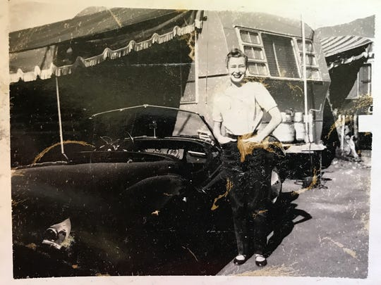 Ginnie Shoemaker stands in front of a trailer she and Bill lived in during his early years as a jockey.