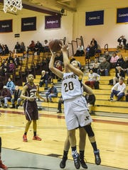 Jefferson's Taylor Langan goes up for a jumper during a Morris County Tournament semifinal last winter.