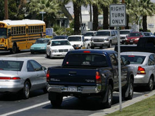 Traffic comes to a stop on Ramon Road in this Desert Sun file photo. Ramon Road is among several major streets prioritized for a valleywide traffic signal synchronization project.
